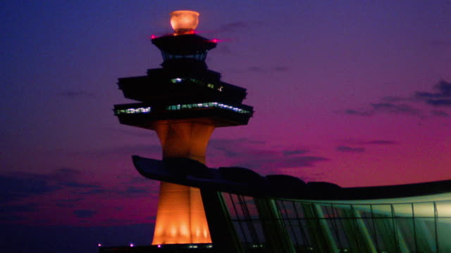 Time lapse clouds moving over Dulles Airport control tower at dusk / Washington D.C.