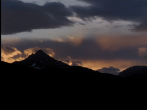 time lapse clouds moving over silhouette of mountain at sunset / patagonia, south america - argentina stock videos & royalty-free footage