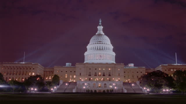 time lapse clouds over Capitol Building at night / Washington D.C.
