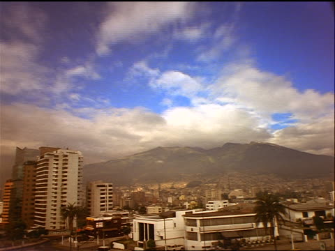 time lapse clouds over city / mountains in background / Quito, Ecuador