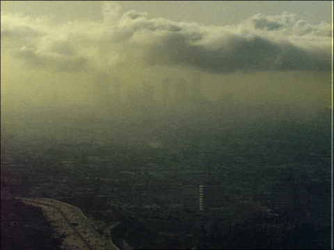 time lapse clouds over los angeles with smog and traffic - londonalight stock videos and b-roll footage