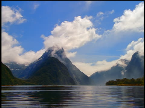 time lapse clouds over Mitre Peak + Milford Sound / South Island, New Zealand
