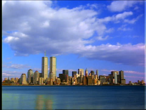 time lapse clouds over new york city skyline / ny - world trade center manhattan stock-videos und b-roll-filmmaterial