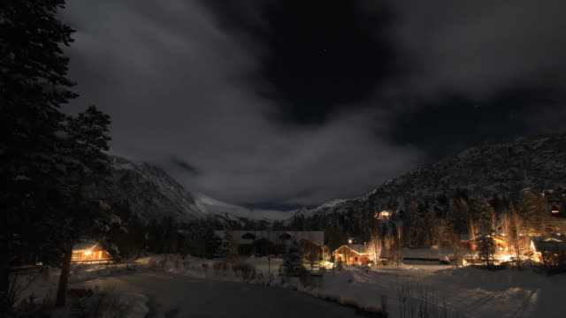 time lapse clouds over snow covered mountains - log cabin stock videos & royalty-free footage