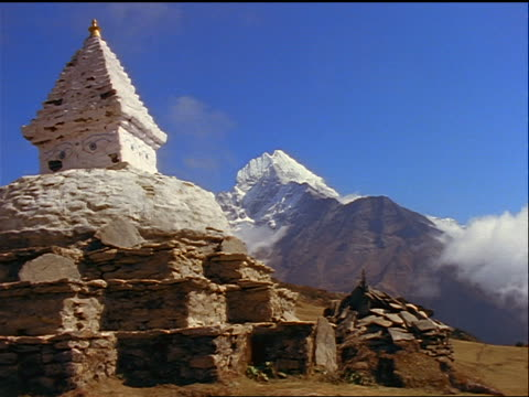 time lapse clouds over  stupa (Buddhist shrine) / Ama Dablam mountain in background / Himalayas