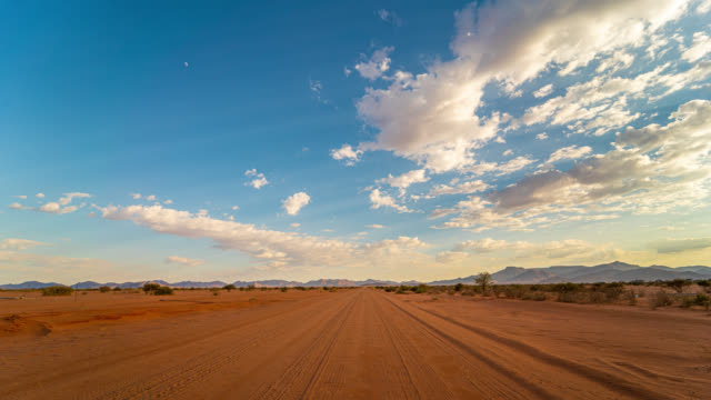ws time lapse clouds over sunny desert landscape, namibia, africa - dirt track stock videos & royalty-free footage