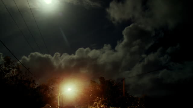 time lapse clouds passing at night above road - moving past stock videos & royalty-free footage