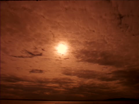 time lapse clouds passing in front of sun in orange sky / nepal - 1997 stock videos and b-roll footage
