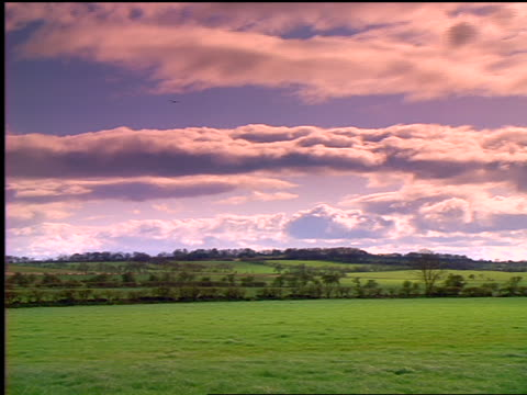 time lapse clouds passing over green fields / st. andrews, scotland - st. andrews scotland stock videos & royalty-free footage