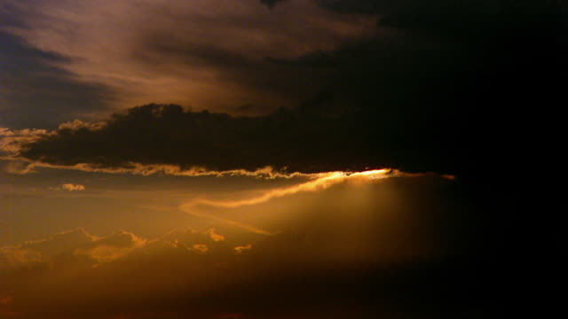 time lapse clouds rolling in sky with sun setting in background - 1989 stock videos & royalty-free footage
