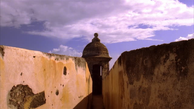 time lapse clouds rolling over top of a garita on fort san felipe del morro / old san juan, puerto rico - 16th century style stock videos and b-roll footage