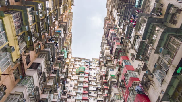 time lapse cloudy sky apartment buildings  in hong kong city - victoria peak stock videos & royalty-free footage