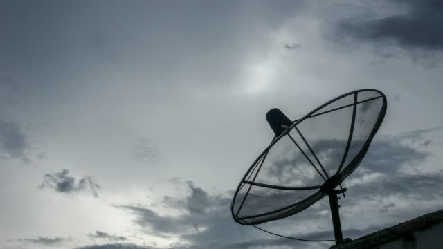 Time lapse : Communication satellite dish antenna (Zoom shot)