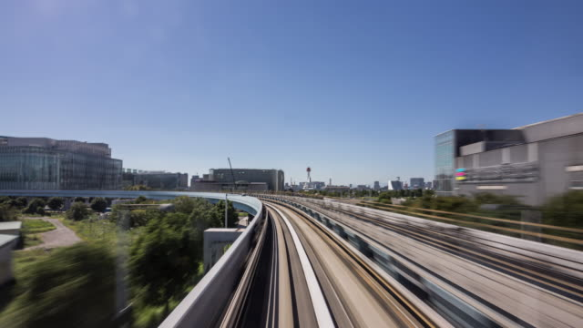 time lapse - commuter train speeding through tokyo - diminishing perspective stock videos & royalty-free footage