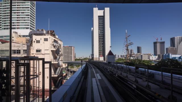 Time Lapse - Commuter Train Speeding Through Tokyo