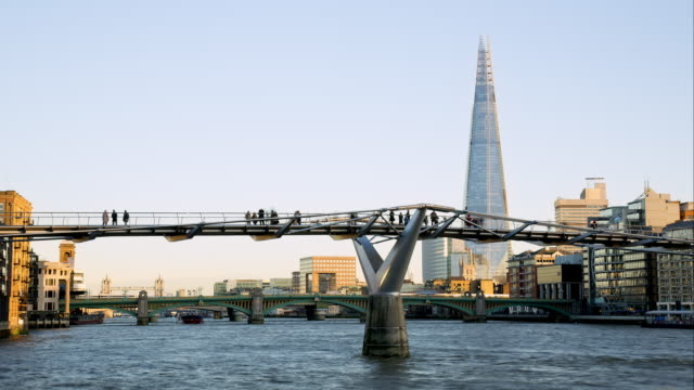 ms  time lapse commuters and tourists on millenium bridge - footbridge stock videos & royalty-free footage