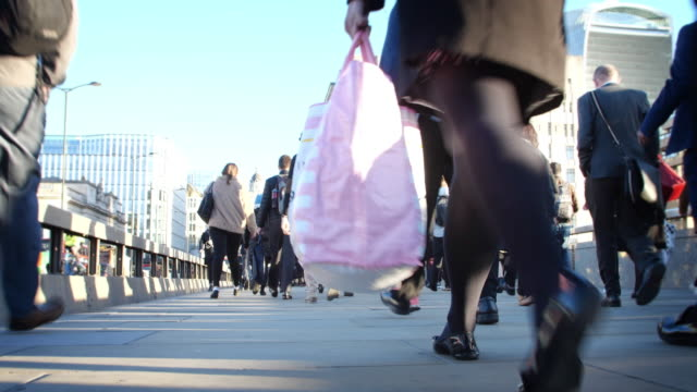 time lapse commuters walking to work. low angle view. - london bridge england stock videos & royalty-free footage