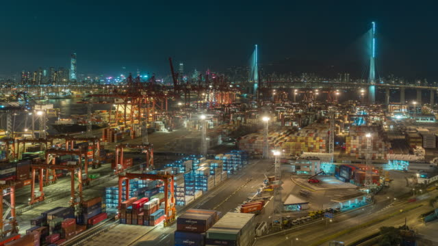 4k time lapse : container cargo warehouse at terminal commercial port and working crane bridge load or unload container with cityscape background at night for business logistics, import export, shipping or transportation. - freight elevator stock videos & royalty-free footage