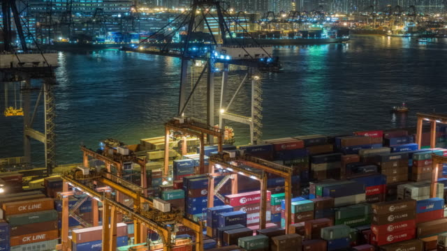 4k time lapse : container cargo warehouse at terminal commercial port and working crane bridge load or unload container at night for business logistics, import export, shipping or transportation. - freight elevator stock videos & royalty-free footage