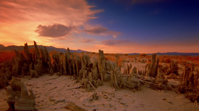 time lapse crane shot sand, rocks, and debris in death valley desert at sunset - death valley national park stock videos & royalty-free footage