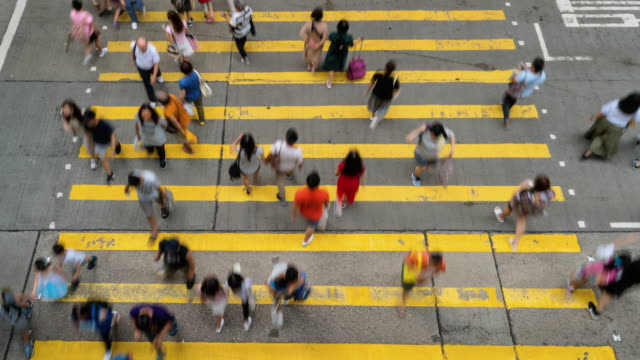 time lapse crowd of pedestrians crossing in mong kok - mong kok stock videos & royalty-free footage