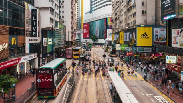 4k time lapse crowd of pedestrians crossing over the crosswalk in causeway bay, hong kong - hong kong stock videos & royalty-free footage