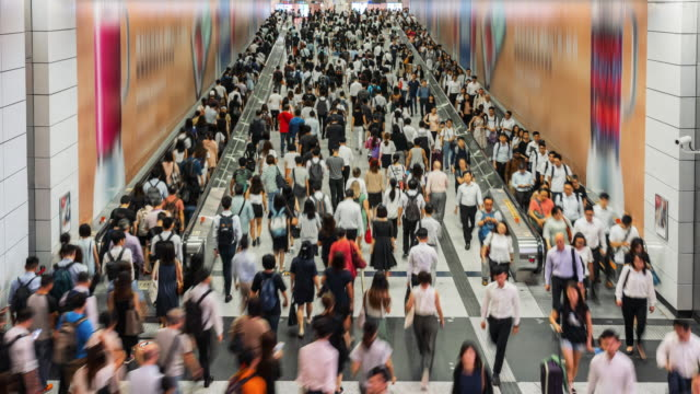 4k time lapse crowd of pedestrians walking in subway transportation hub in rush hour, hong kong - crowded stock videos & royalty-free footage