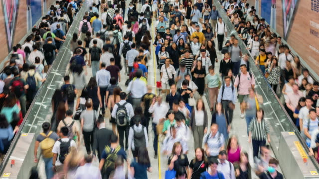 4k time lapse crowd of pedestrians walking in subway transportation hub in rush hour, hong kong - population explosion stock videos & royalty-free footage