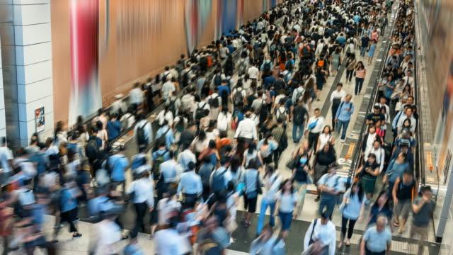 4k time lapse crowd of pedestrians walking in subway transportation hub in rush hour, hong kong - station stock videos & royalty-free footage