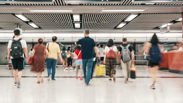 time lapse crowd of pedestrians walking in subway transportation hub in rush hour, hong kong - passenger stock videos & royalty-free footage