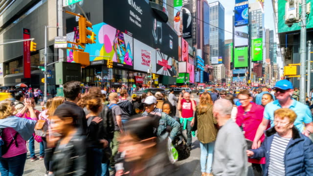 time lapse crowd of tourist walking at times square - times square manhattan stock videos & royalty-free footage