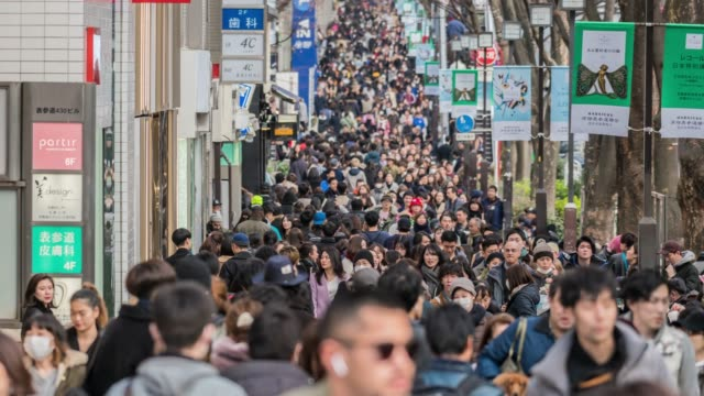 4k time lapse crowd of undefined people prevent freedom of movement walking on the street around fashion mall in harajuku tokyo city, japan. japanese culture and congestion concept - capital cities stock videos & royalty-free footage
