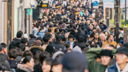 4K Time lapse crowd of undefined people prevent freedom of movement walking on the street around fashion mall in Harajuku Tokyo city, Japan. Japanese culture and congestion concept