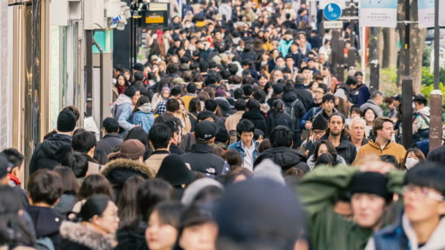 4k time lapse crowd of undefined people prevent freedom of movement walking on the street around fashion mall in harajuku tokyo city, japan. japanese culture and congestion concept - fast motion stock videos & royalty-free footage