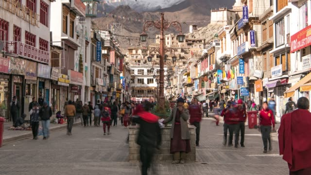 4K Time lapse : crowd people Leh Ladakh walking in night market and   with Himalayan mountains  at Jammu and Kashmir,  Northern India