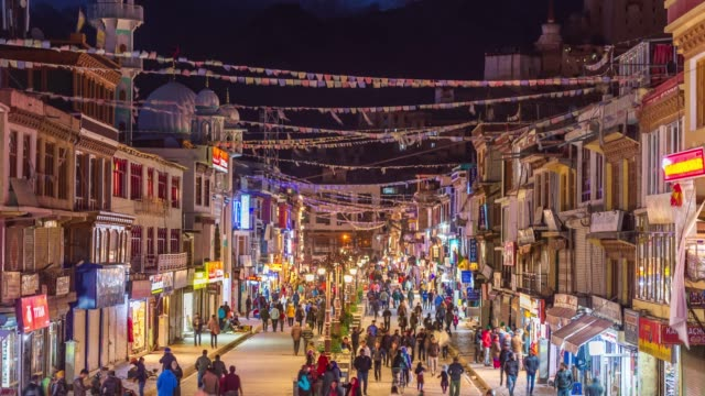 4k time lapse : crowd people walinkg night market in leh city on season winter -  norther part of india  mountains snow peaks in leh district, ladakh jammu and kashmir - india stock videos & royalty-free footage