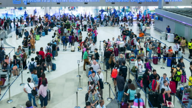 time lapse crowd queueing up for check in at airport - line up stock videos and b-roll footage