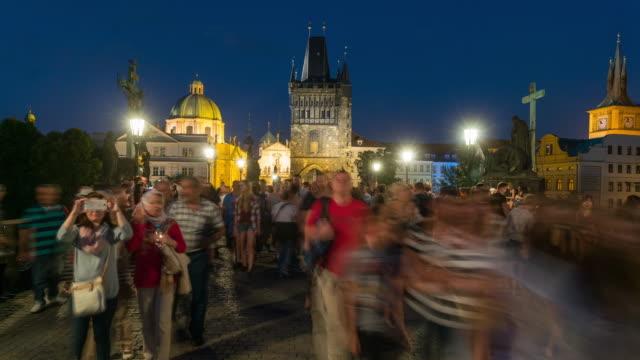time lapse, crowd walking at charles bridge at dusk, prague - 14th century bc stock videos & royalty-free footage