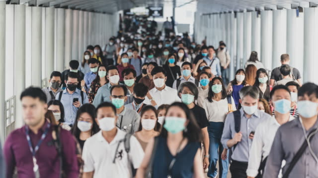 time lapse crowded of people wearing a face mask to prevent coronavirus or covid-19 outbreak - elevated train stock videos & royalty-free footage