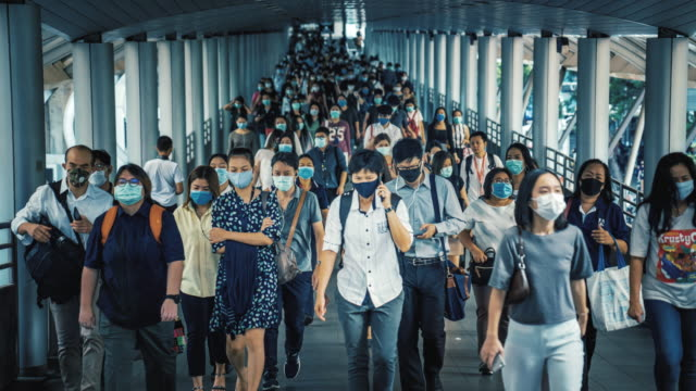 time lapse crowded of people wearing a face mask to prevent coronavirus or covid-19 outbreak - timelapse stock videos & royalty-free footage