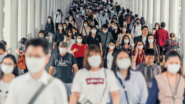 time lapse crowded of people wearing a face mask to prevent coronavirus or covid19 outbreak - pedestrian walkway stock videos & royalty-free footage