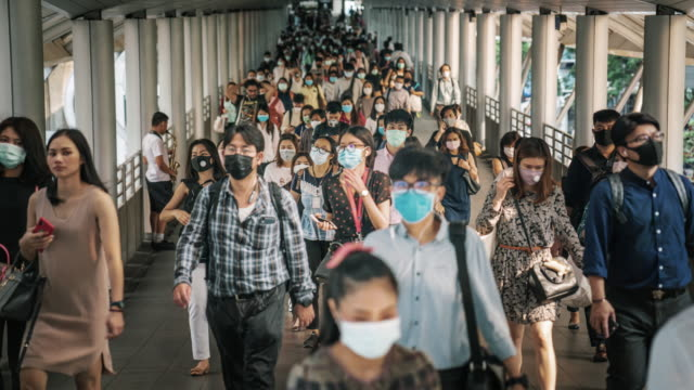 time lapse crowded of people wearing a face mask to prevent coronavirus or covid-19 outbreak - symptom stock videos & royalty-free footage