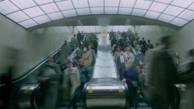 time lapse crowds on escalators in grand central station / new york city - escalator stock videos & royalty-free footage