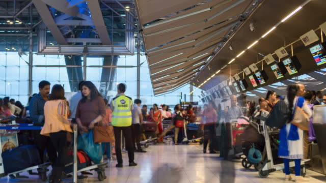 4K Time Lapse: Crowed Airport Departure Check-in hall, Zoom in shot