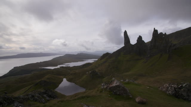 time lapse. dark clouds are moving at the old man of storr on the isle of skye. old man of storr, isle of skye, inner hebrides, scotland, united kingdom, europe - scottish highlands stock videos and b-roll footage