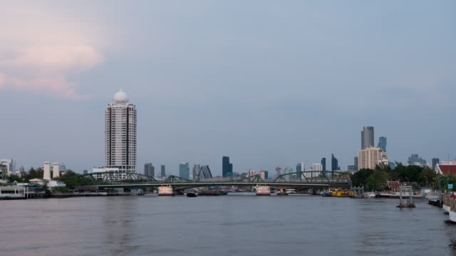time lapse dat to night chao phraya river with memorial bridge in background,bangkok thailand - sequential series stock videos & royalty-free footage