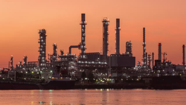 4k time lapse dawn to day : oil refinery for energy or gas industry. - dawn to day stock videos & royalty-free footage