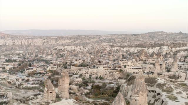 time lapse: day time to sunset to night in small turkish town - cappadocia, turkey - トルコ点の映像素材/bロール