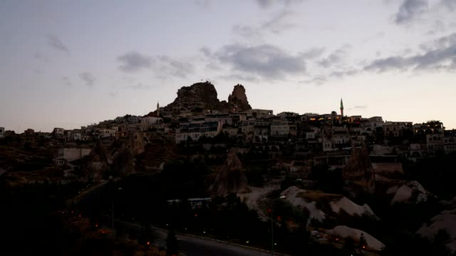 time lapse day to night at uchisar, cappadocia - mesopotamia stock videos and b-roll footage