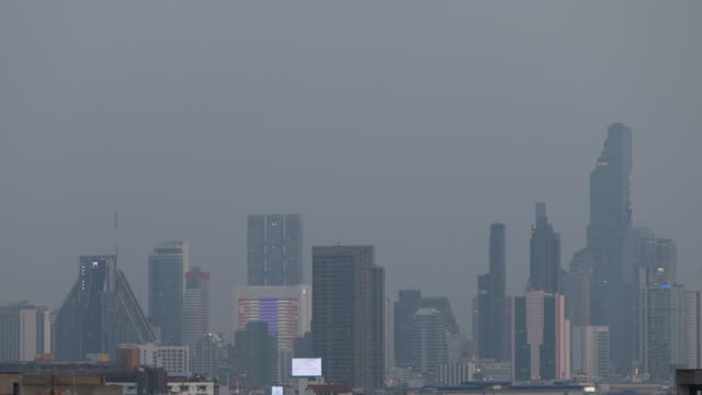 time lapse day to night buildings in bangkok under pm2.5 dust air pollution ; shift motion - sequential series stock videos & royalty-free footage